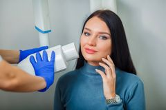 Dentist doctor doing dental treatment teeth patient girl in dental office royalty free stock photos