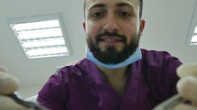 Dentist doctor happy  examines a patient`s mouth  teeth  professional  smile. Check stock video