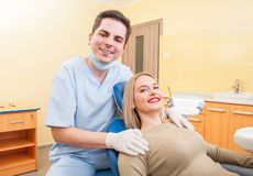 Dentist doctor and patient smiling Stock Photos