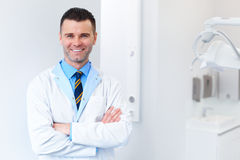 Dentist Doctor Portrait. Young Man at His Workplace. Dental Clin Stock Photos