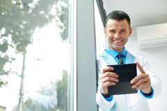 Dentist Doctor Takes Photo Using His Smartphone. Royalty Free Stock Photos