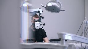 Dentist does a surgery in modern clinic.  stock footage