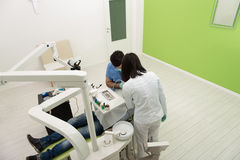 Dentist Doing A Dental Treatment On Patient Royalty Free Stock Photography