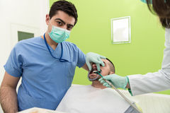Dentist Doing A Dental Treatment On Patient Stock Photo