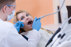 Dentist drilling a tooth Royalty Free Stock Photography