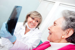 Dentist with an elder patient Royalty Free Stock Image
