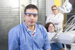 Dentist  in exam room Stock Image