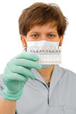 The dentist examine the color for the tooth Stock Photography