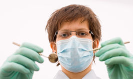 The dentist examine the patient. The sweet young dentist examine the patient Stock Photo