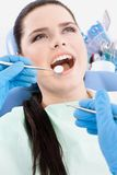 Dentist examines the mouth of the patient Stock Photo