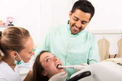 Dentist examines the oral cavity stock images