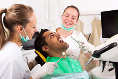 Dentist examines the oral cavity. On computer equipment. Focus on the man stock photos