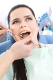 Dentist examines the oral cavity of the patient Royalty Free Stock Photo