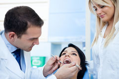 The dentist examines a patient Stock Photography