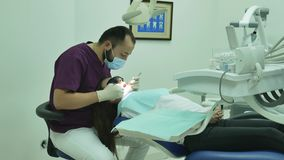 Dentist examines a woman patient  medical clinic dental equipment. Dentist examines a woman patient medical clinic dental equipment smile happy stock video footage