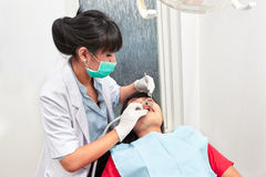 Dentist examing teeth Stock Photos