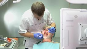 Dentist examining elderly patient. stock video footage