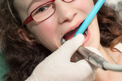 Dentist examining a girl Royalty Free Stock Photos