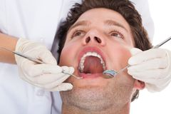 Dentist Examining Patient Stock Photo