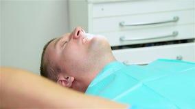 Dentist Examining Patient stock video