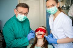 Dentist examining a patient`s teeth in the dental clinic. stock images