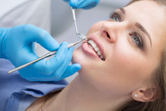 Dentist examining a patient's teeth in the dentist. Stock Photos