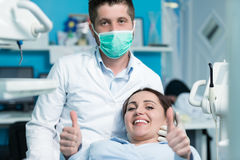 Dentist examining Patient teeth with a Mouth Mirror. Royalty Free Stock Photography