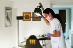 Dentist examining a patient teeth. Dentist office. royalty free stock photography