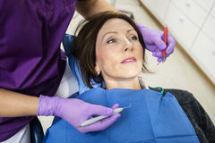 Dentist Examining Patient With Tools In Clinic Royalty Free Stock Images