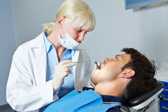 Dentist examining patient with toothache Royalty Free Stock Photo