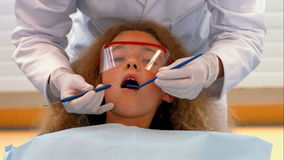 Dentist examining a patients teeth. At the dental office stock footage