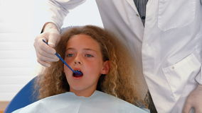 Dentist examining a patients teeth. At the dental office stock video footage
