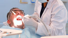 Dentist examining a patients teeth. At the dental office stock video