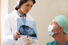 Dentist Examining X-Ray Royalty Free Stock Image