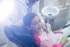 Dentist examining a young patient with tools Stock Photography