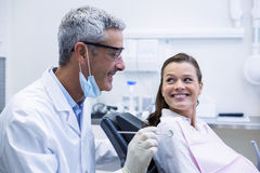 Dentist examining a young patient with tools. In dental clinic Royalty Free Stock Photo