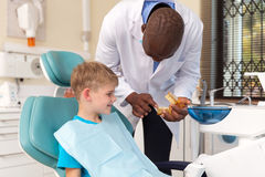 Dentist explaining dental procedure Stock Photo