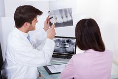 Dentist explaining dental xray to patient Stock Photo