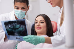 Dentist explaining the details of x-ray picture to his patient Stock Images
