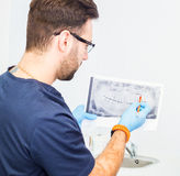 Dentist explaining x ray picture to patient. Stock Photo