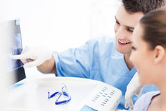 Dentist explaining x ray picture to patient Stock Photo