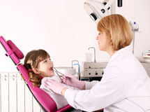 Dentist extracted the tooth little girl Royalty Free Stock Image