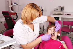 Dentist extracted the tooth a little girl Stock Photography