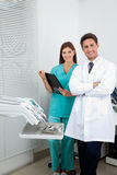 Dentist And Female Assistant In Clinic Royalty Free Stock Photos
