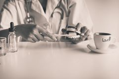 Dentist female diagnose plastic teeth models with toothbrush,Concept of dental checking,Selective focus denture. Black and white toned Royalty Free Stock Photography