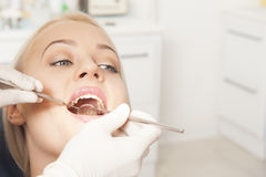 Dentist. And a female patient Stock Photo