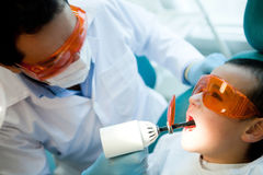 Dentist fixing a cavity Royalty Free Stock Image
