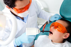 Dentist fixing a cavity Stock Photography