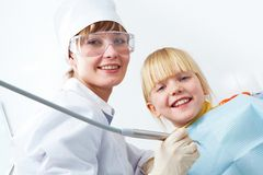 Dentist and girl Stock Images