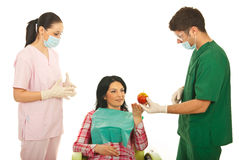 Dentist gives apple to patient Royalty Free Stock Images